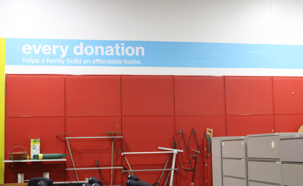 "ashland restore wall that reads ""every donation helps a family build an affordable home"""